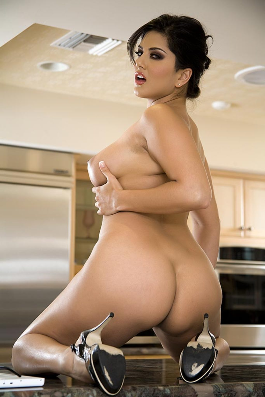 Sunny leone strips with a banana